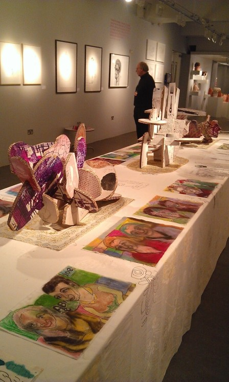 Table adorned with works by various artists
